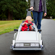 This Awesome Baby's Marty McFly Costume and DeLorean Push Car Is Absolutely Adorable
