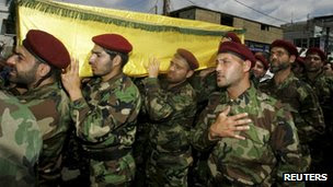 Fighters loyal to Hezbollah bury a fighter, 26 May 2013