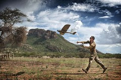 A soldier launches a Desert Hawk, Unmanned Aer...