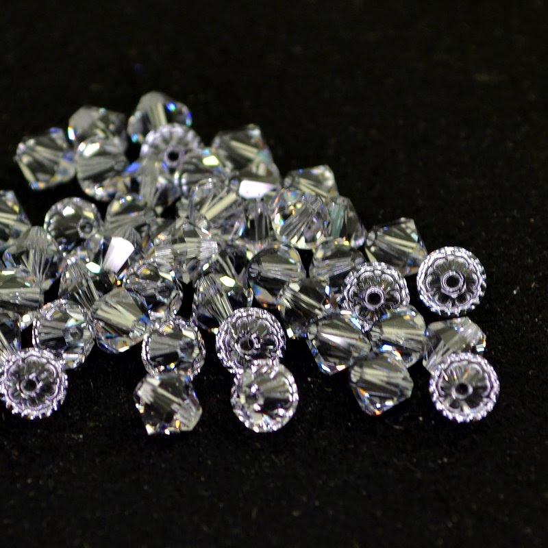 27753012015265 Swarovski Elements Bead - 6 mm Faceted Xilion Bicone (5328) - Smokey Mauve (1)