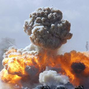 Imperialist warplanes drop bombs on vehicles in the eastern region of Libya. The North American capitalist states and their allies in Europe have launched bombing operations against the North African state of Libya. by Pan-African News Wire File Photos