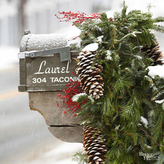 Mailbox decorated for Christmas with greenery, pinecones, and berries | Friday Christmas Favorites at www.andersonandgrant.com