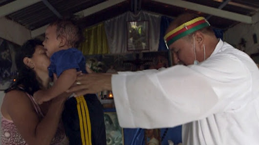 Video: Colombian Exorcist Performs Fire-Fueled Rituals