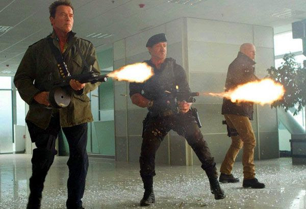 The Terminator, Rambo and John McClane team up to shoot the bad guys in THE EXPENDABLES 2.