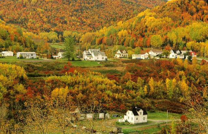 The village of Petit-Riviere-au-Renard in Fall, Gaspé, Quebec, Canada with it's leaves bursting with red and gold, makes for an idyllic location for a romantic holiday.
