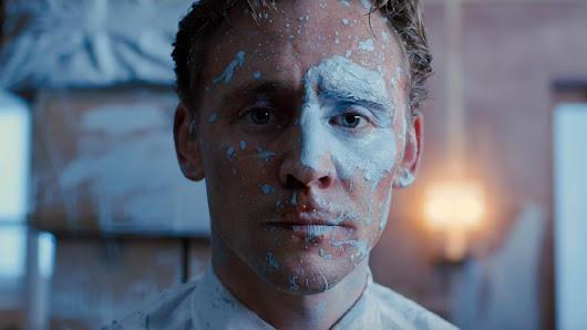Tom Hiddleston Loses His Mind in New HIGH-RISE Trailer | Nerdist