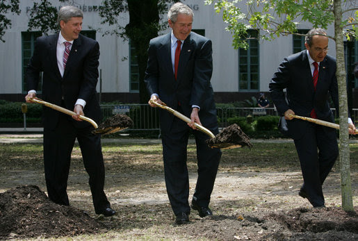 President George W. Bush, Canadian Prime Minster Stephen Harper and Mexico's President Felipe Calderon carry shovels of dirt at a tree planting ceremony in honor of Earth Day Tuesday, April 22, 2008 at Lafayette Square in New Orleans. White House photo by Chris Greenberg