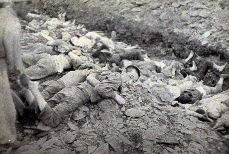 "This U.S. Army photograph, once classified ""top secret"", is one of a series depicting the summary execution of 1,800 South Korean political prisoners by the U.S.-backed South Korean military at Taejon, South Korea, over three days in July 1950. Historians and survivors claim South Korean troops executed many civilians behind frontlines as U.N. forces retreated before the North Korean army in mid-1950, on suspicion that they were communist sympathizers and might collaborate with the advancing enemy."