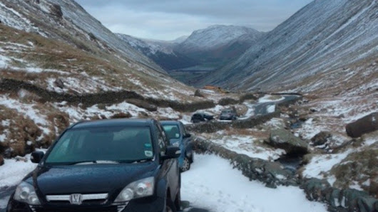 Cars abandoned on snow-covered Kirkstone pass