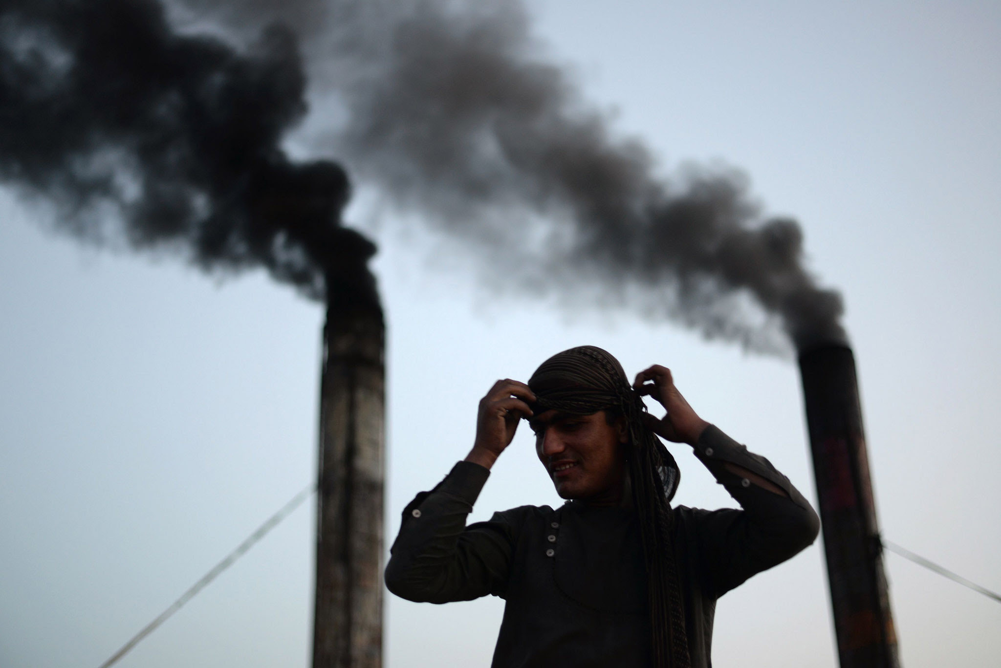 Afghan labourer Hamid Gul, 25, working at a brick factory on the outskirts Mazar-i-Sharif