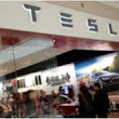 Tesla takes on America's car dealers