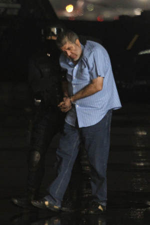 Drug boss Vicente Carrillo Fuentes is led towards a…