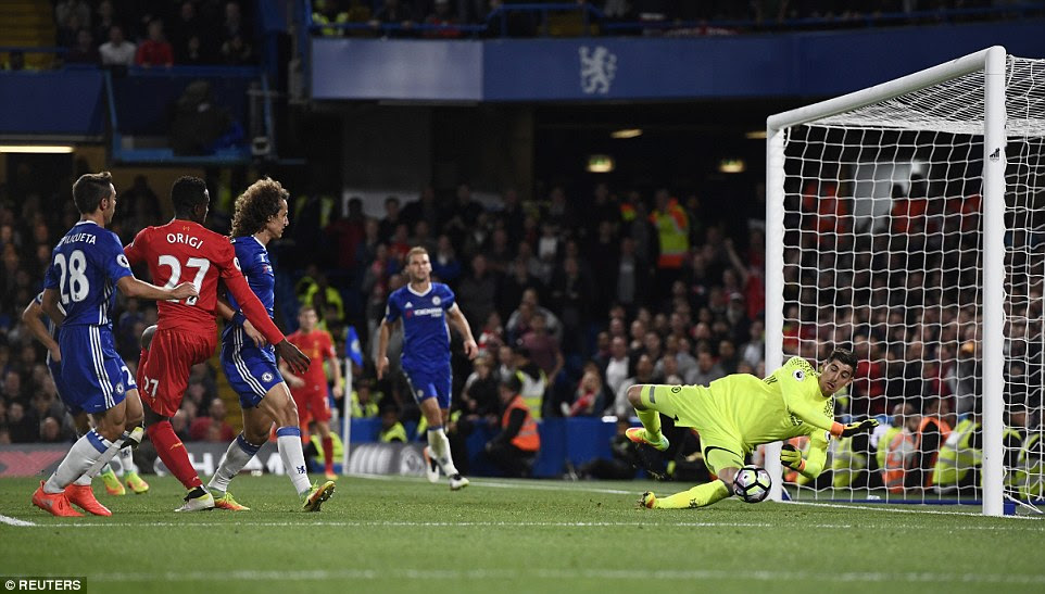 Substitute Divock Origi (second left) missed a close range header to put the game out of Chelsea's reach