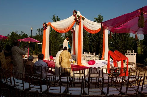 Orange and red Indian wedding mandap Image by Regeti 39s Photography