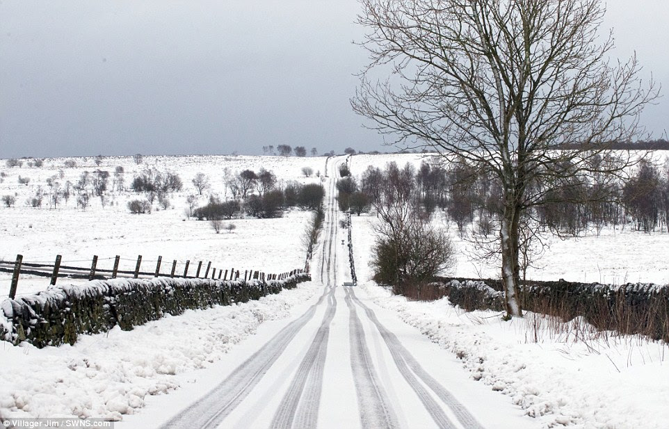 More snow to come: An Arctic blast will sweep across Britain this weekend bringing more extreme weather. Pictured, Curbar, Derbyshire today
