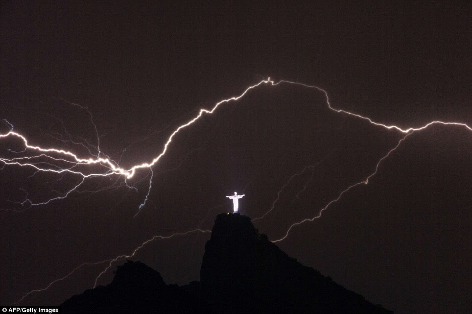Awesome: Lightning flashes over the Christ the Redeemer statue on top of Corcovado Hill in Rio de Janeiro on January 14, 2014