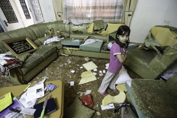 Israeli soldiers used knives from the kitchen to destroy furniture throughout the Qawasmeh  home. (Photo: Kelly Lynn)