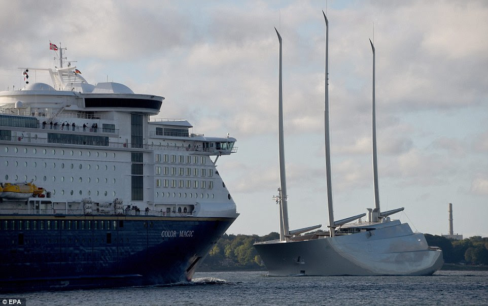 The 468ft-long vessel (right), owned by Russian billionaire Andrey Igorevich Melnichenko, was reportedly pulled out of the German Naval Yards in Kiel, north of Hamburg, by a tugboat and it eventually built up a speed of 20 knots on another test run