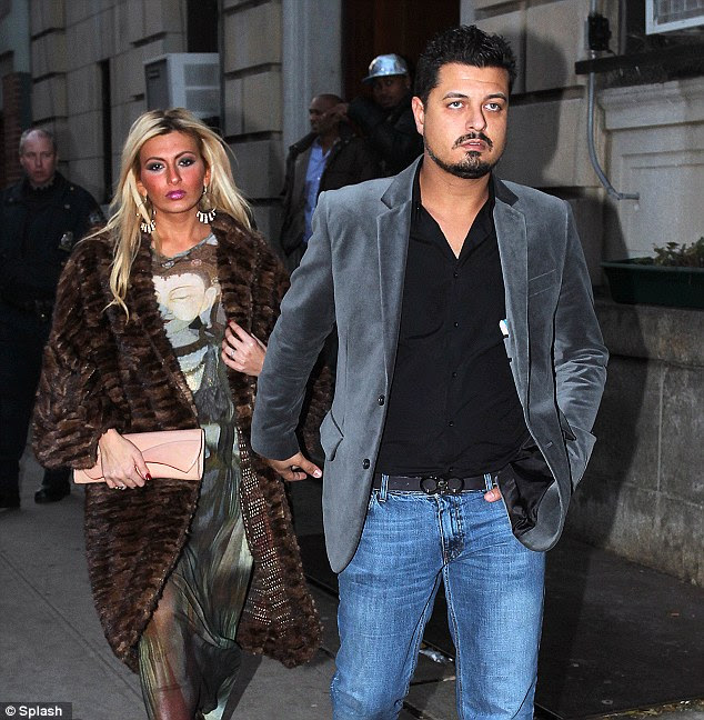 Trouble: Alleged Lindsay Lohan victim Tiffany Mitchell leaves the police station with a man believed to be her husband