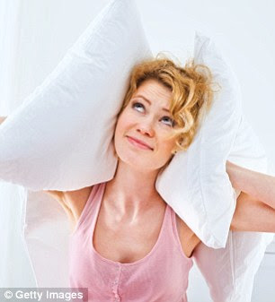 Most down and synthetic pillows are machine washable and should be cleaned every three months (picture posed by model)
