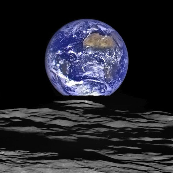 An image of Earth and the Moon taken by NASA's Lunar Reconnaissance Orbiter spacecraft...on October 12, 2015.