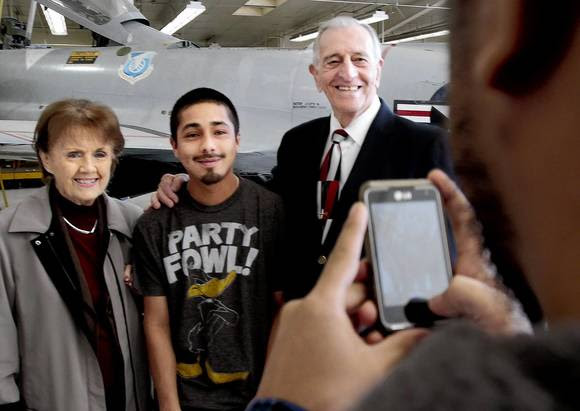 Mechanical aviation student Isac Ramos, center, poses with Betty and Si Robin.