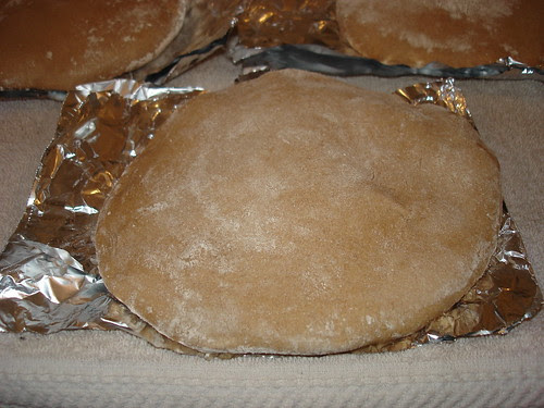 A pita cooling outside the oven