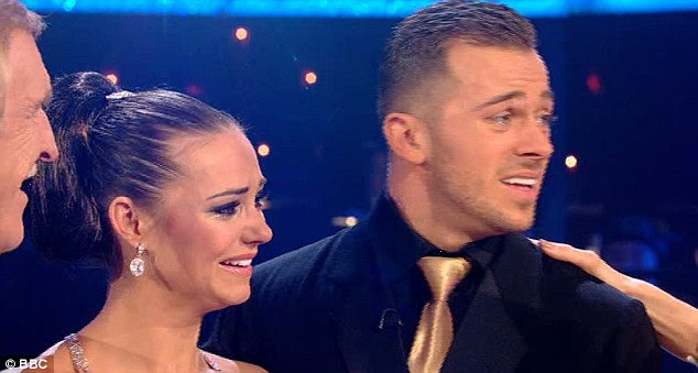 Thrilled: Both Kara and Artem struggled to contain their emotions as they accepted the trophy