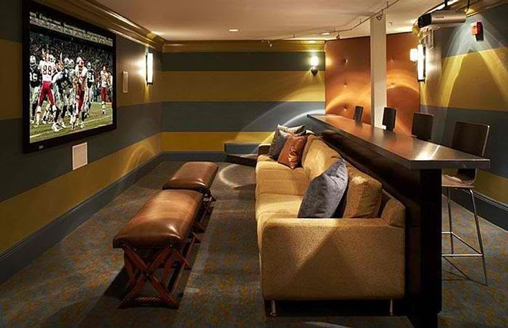 Theater seating with bar seating behind the sofa
