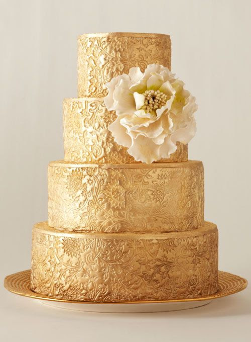 Brides.com: 34 Stunning Wedding Cakes for a Winter Wedding | Gold plated wedding cake with a peony by City Sweets & Confections
