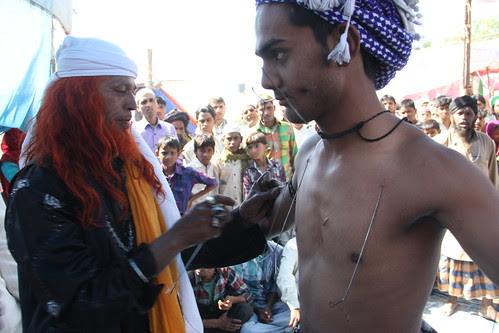 Hyder Ali Baba Pierces His Son At Makanpur Urus  2013 by firoze shakir photographerno1