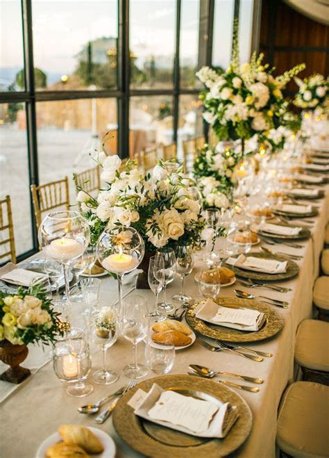 Elegant banquet tables were covered with green and white