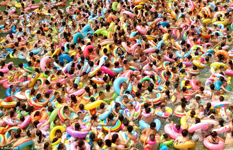 Swimmers wrestle with colourful rubber rings at a pool in Daying county, Sichuan Province, this past August, in a situation that looks anything but relaxing