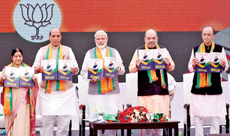 Indian Prime Minister Narendra Modi (C), chief of India's ruling Bharatiya Janata Party (BJP) Amit Shah (2-R), India's Home Minister Rajnath Singh (2-L) India's Foreign Minister Sushma Swaraj (L) and India's Finance Minister Arun Jaitley display copies of their party's election manifesto for the April/May general election, in New Delhi, India on Monday.