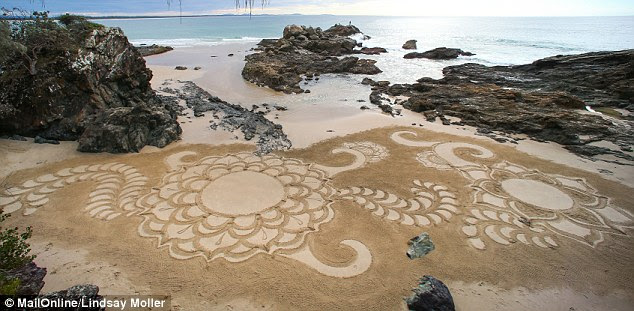 The 24-year-old from Lake Cathie, NSW, works in the wet sand at low tide meaning her drawings don't stick around for long when the waves roll in