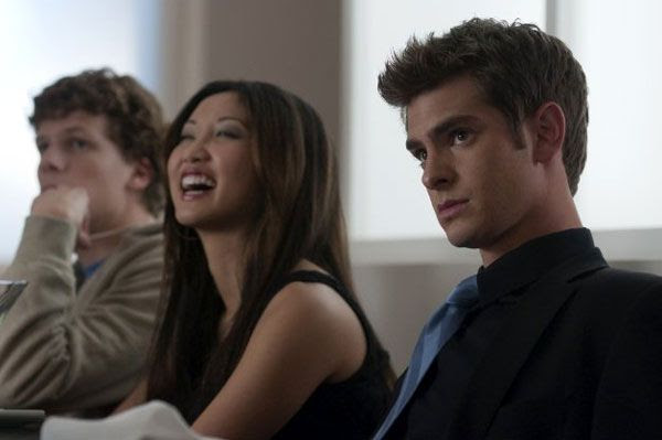 Jesse Eisenberg, Brenda Song and Andrew Garfield in THE SOCIAL NETWORK.