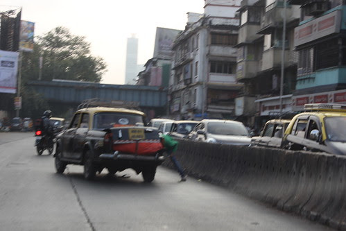 This Druggie Of Dadar Jumped Of The Divider ,,,Straight Into The Moving Cab by firoze shakir photographerno1