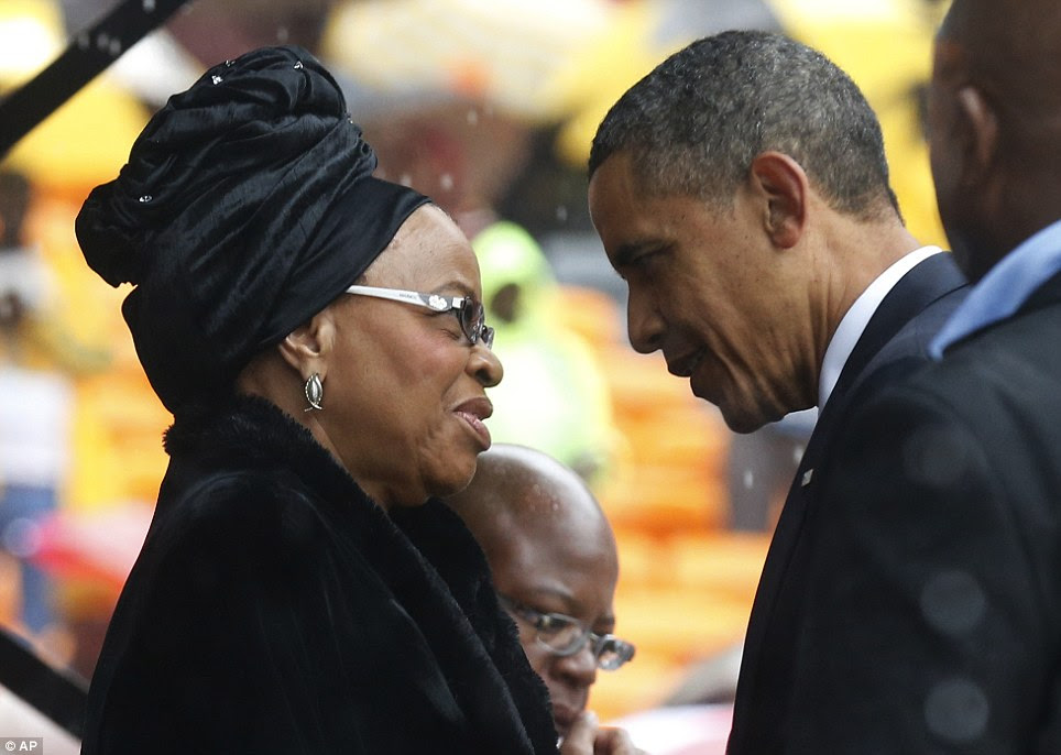 Mutual respect: President Obama speaks to Nelson Mandela's widow Graca Machel during the memorial service