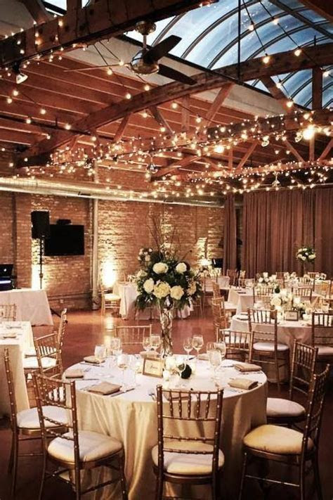 Indoor winter wedding reception with twinkly lights and