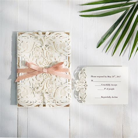 exclusive ivory laser cut wedding invitation with glitter