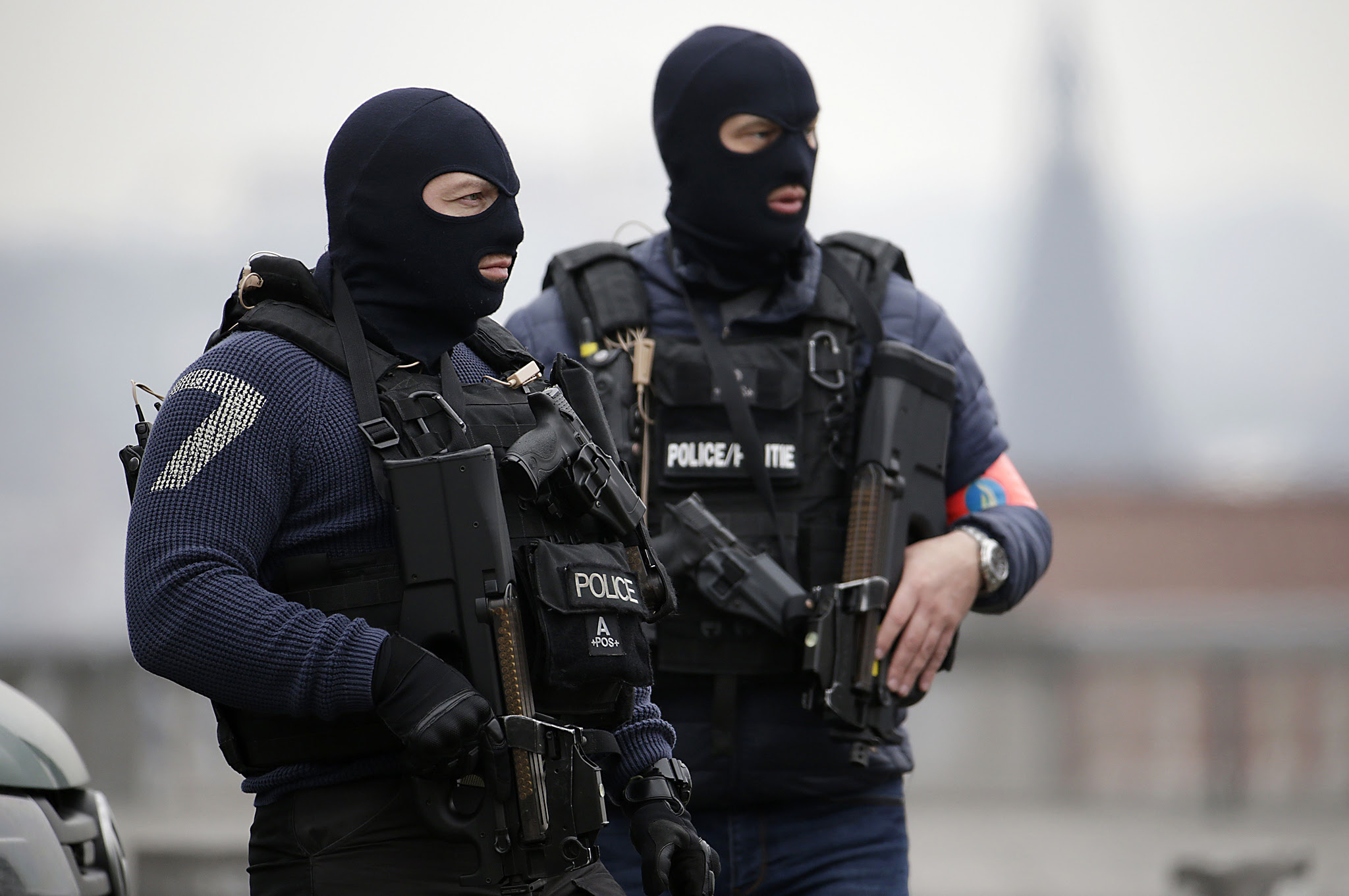 Special police forces stand guard outsid...Special police forces stand guard outside the Council Chamber of Brussels on March 24, 2016 during investigations into the Paris and Brussels terror attacks. More than 30 people have been identified as being involved in a network behind the Paris attacks on November 13, with links now established to this week's bombings in Brussels. AFP PHOTO / KENZO TRIBOUILLARDKENZO TRIBOUILLARD/AFP/Getty Images