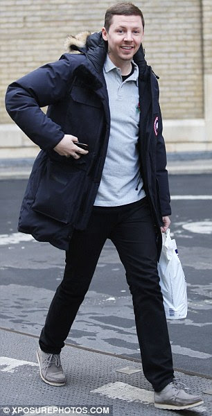 Casual: The musician was seen running errands in London in a low-key grey polo neck, black jeans and grey loafers