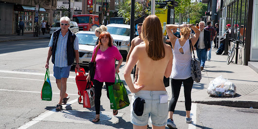 Topless Journalist Walks Around Downtown Montreal (NSFW)