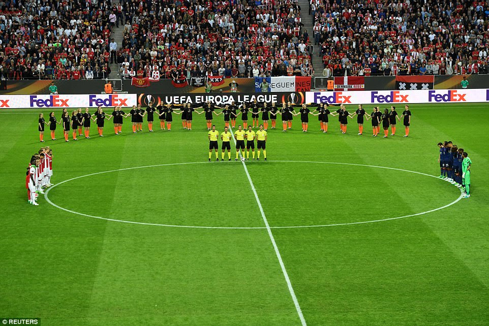 The players gathered on the edge of the centre circle to pay their respects before kick-off in this Europa League final