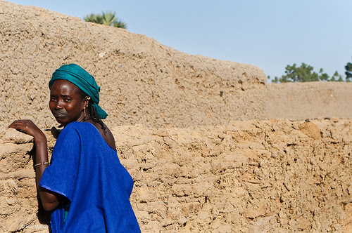 Puel/Fulani woman peering over her wall - Senosa, Mali by Phil Marion ( 2 million Thank Yous)