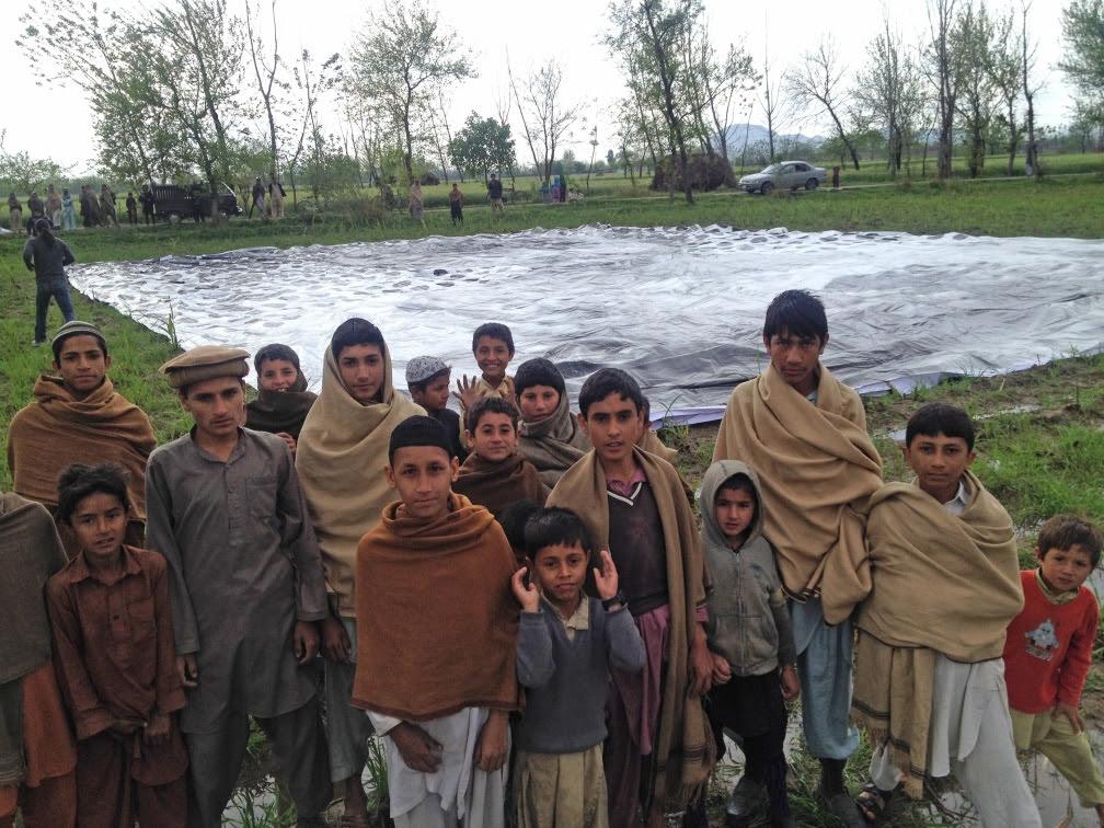 Children gather around the installation
