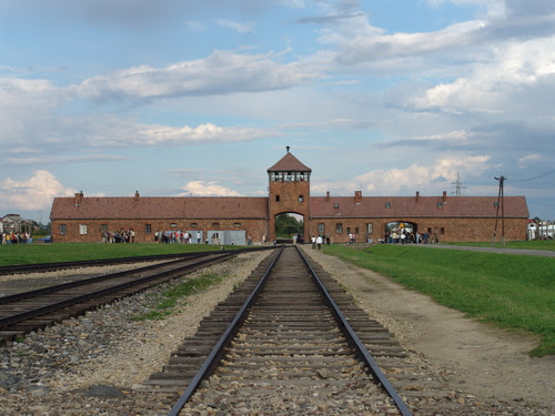 Click photo to download. Caption: The railway leading up to the main gate at the Nazis' former Auschwitz II (Birkenau) concentration camp. Credit:Michel Zacharz via Wikimedia Commons.