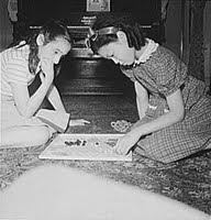 New York, New York. Chinese-American playing Chinese checkers with a Jewish friend in a Flatbush home. Collins, Marjory, 1912-1985, photographer.