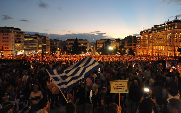 GREECE, Athens: Protesters turn out in droves to Syntagma Square outside the Parliament of Greece on June 18, 2015, demanding that Greece remain in the European Union and urging the Syriza government to reach agreement with lenders.
