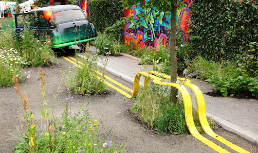 Parked Bench: Yellow Lane Lines Morph into Improbable Urban Seating